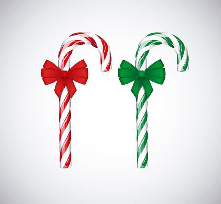 Traditionele kerst groene en rode snoep stokken met rode strik lint op een witte achtergrond.