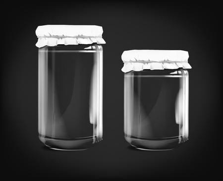 Empty glass jar isolated on dark background.