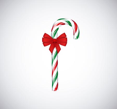 Cannes de bonbon traditionnelles de Noël vert et rouge avec ruban arc rouge isolé sur fond blanc.