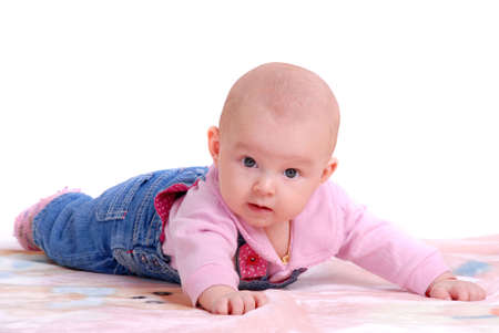 Small child in jean combination on pink plaid photo