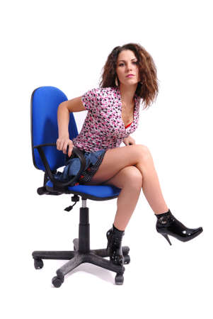 A sexual girl sits on a chair photo