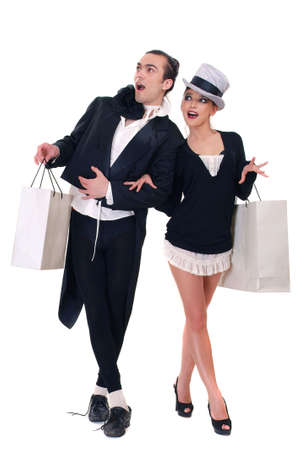 Man and woman with bags on a white background photo