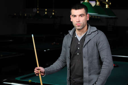 Portrait of a young man playing snooker photo