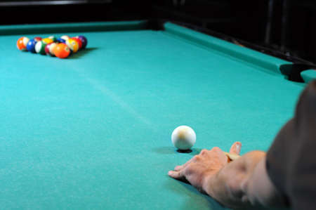snooker rooms: Man playing snooker in the dark club