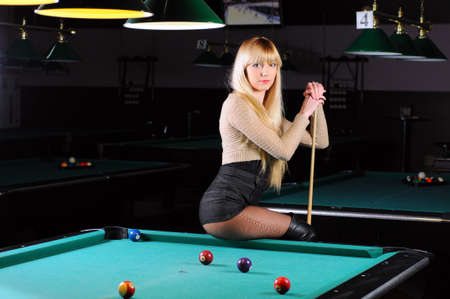 trajectory: Young girl playing snooker Stock Photo