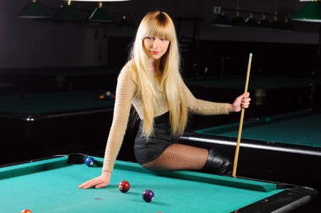 pool ball: Young girl playing snooker Stock Photo