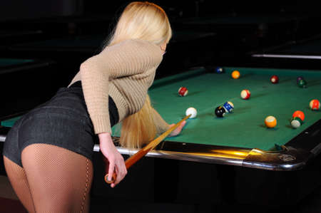 Young girl playing snooker photo
