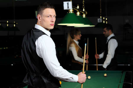 billard: portrait of a young professional player before playing snooker  Billiards