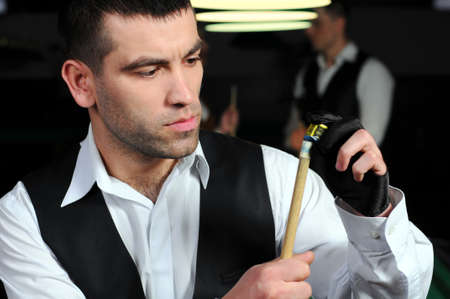 poolball: portrait of a young professional player before playing snooker  Billiards