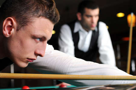 poolball: young professional people play snooker