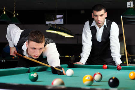 billard: young professional people play snooker