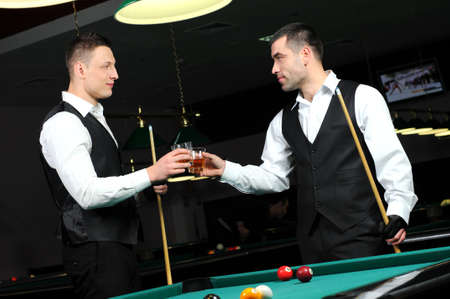 poolball: Young people with drinks in their hands to play snooker at the club
