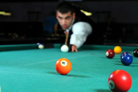 contender: Young person playing snooker in a club