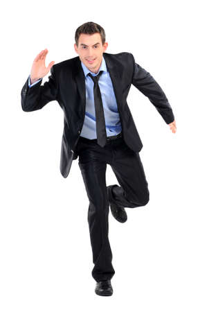businessman running: young business man running isolated on white background