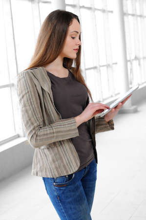 young girl with a tablet in office photo