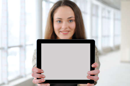 young girl with a tablet in office  focus tablet photo