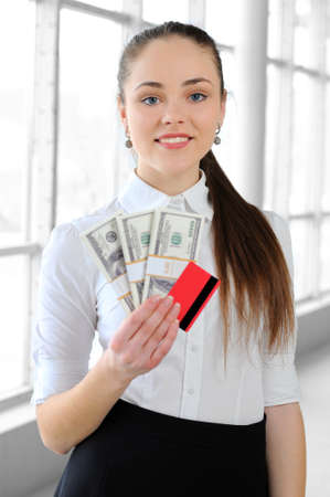 portrait of a young business girl with money in the office Stock Photo - 20706200