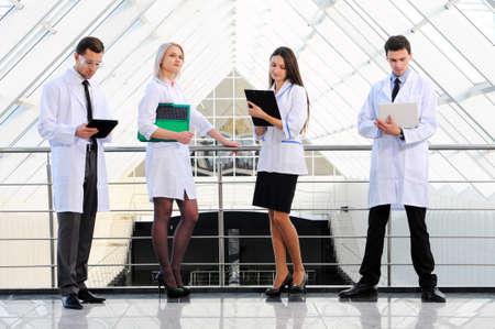 modern hospital: doctors do their job against modern hospital building