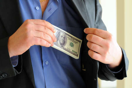 putting money in pocket: Man in a putting money in his pocket