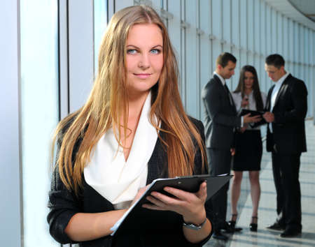 beautiful business woman on the background of business people Stock Photo