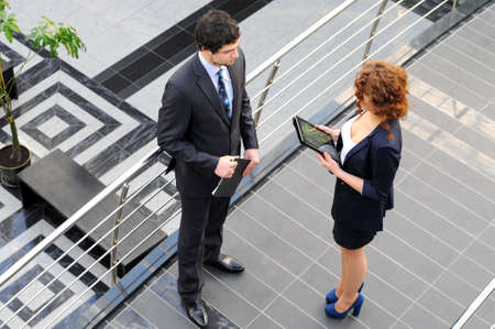 Confident business partners in office building  view from above