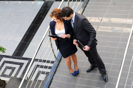 Confident business partners in office building  view from above photo