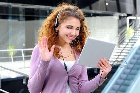 young girl having a video conference photo
