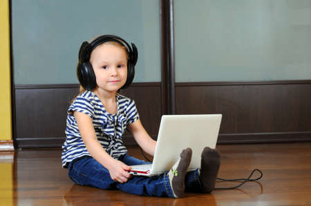 girl in headphones with a laptop photo