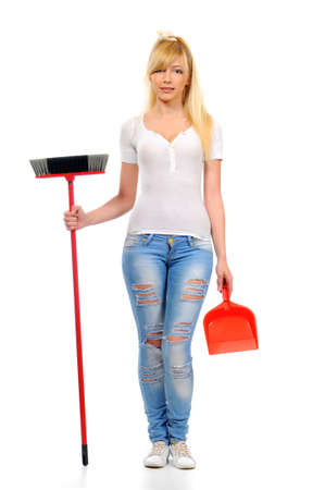 Cleaning woman standing beautiful while spring cleaning with broom  isolated on white background photo