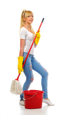 Cleaning woman washing floor with mop and bucket during spring cleaning photo