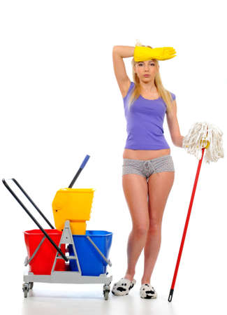 cleaning services: Smiling housewife cleaner  Isolated over white background