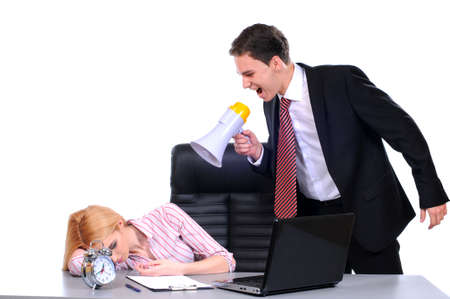 Portrait of business woman sleeping at workplace with businesswoman over waking him up photo