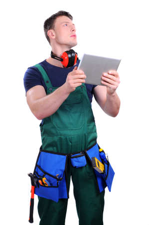 Handsome industrial contractor using wireless tablet device Stock Photo - 20814910