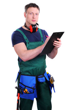 Handsome industrial contractor using wireless tablet device photo