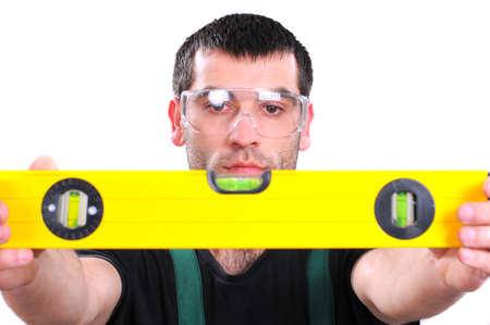 commensurate: Construction worker looks at the spirit level