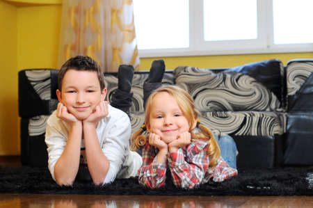 Jolly siblings lying on the floor photo
