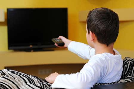 テレビを見ている少年 写真素材