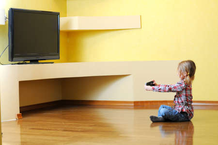 little girl playing with console photo