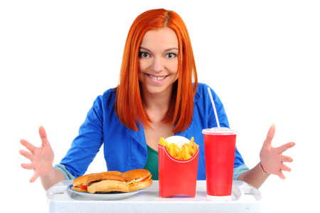 beefburger: Woman eating fast food  Isolated  Stock Photo
