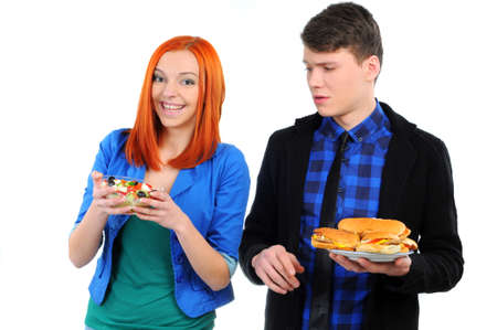 young people eating hamburger and salad