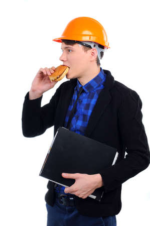 young man in a helmet eating burger photo