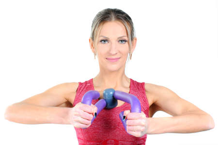 expander: Young beautiful woman during fitness with expander Stock Photo