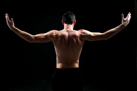 naked black men: portrait of handsome muscleman against dark background