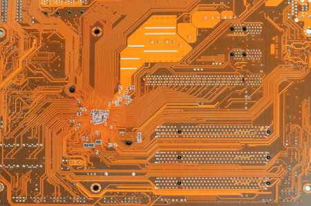 Close up of red computer circuit board as background photo