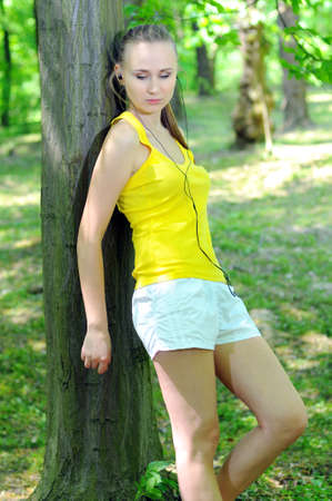Young woman with mp3 player doing fitness in city park Stock Photo - 20818465