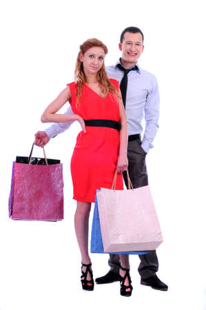 Boy and girl brings bags in different colors Stock Photo - 20818720