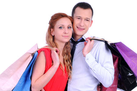 Boy and girl brings bags in different colors  Stock Photo - 20818723