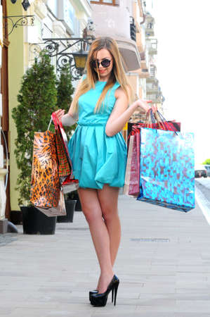 Fashion lady of holding shopping bags in modern city  photo