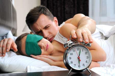 guy turning off alarm clock photo