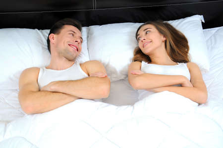 a couple lying in bed photo